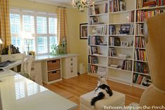 with IKEA Billy Bookshelves - could position around L's desk to integrate furniture together