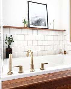 Modern Vintage Bathroom with wood surround tub and brass fixtures