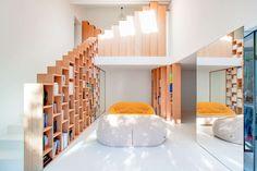 Gleaming Bookshelf House in Paris Stores Creativity [1050x700]