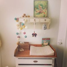 Love that wall art in this vintage nursery!
