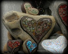 I love the design element of adding the ball chain to these pieces.  I also love that the mosaics are added to beach/river rocks as embellishments.  Gorgeous!... These were made by Chris Emmert.