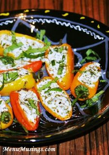 Herbed Goat Cheese Stuffed Mini Peppers - Perfect for those of you who enjoy the flavors and idea of stuffed jalapenos, but have a hard time stomaching (literally) the heat. Step-by-step photo tutorial.