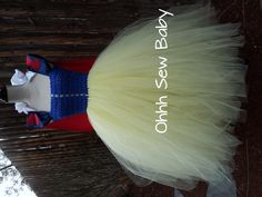 Snow White tutu dress with detachable satin cape. The front of the bodice is woven with tulle. The skirt is 3 full layers with over 900 feet of tulle!