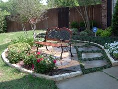 seating area in your front yard nested into the landscape designed and installed by green - Front Patio Ideas