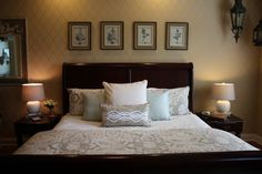 Traditional master bedroom with gray bedding and stenciled wall