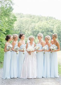 Baby blue and white bridesmaids - click to view more!