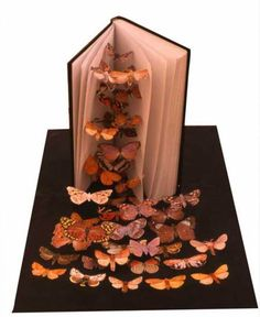 butterfly book by Peter Madden. There's layers of butterflies from the bottom to top of book to create a effect. Altered Books, Altered Art, Peter Madden, Book Crafts, Paper Crafts, Found Poetry, Butterfly Books, Pop Up Art, Book Sculpture