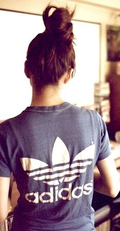 adidas. i used to have this very same shirt, back in 95 or 96. It was actually vintage then! Sigh. Darn you, Carly!