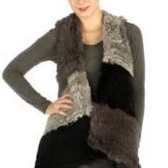 Colorblock Knitted Rex Rabbit Vest Firm This is a multi color gray color block Knitted Rex Rabbit Fur  Vest. This is as seen in Neiman Marcus. These are samples so there is some color variations. This is OS fits most U.S. Women's will fit 0-14. The measurements: 150 cm long, 50 cm wide. This item will be sent Certified Mail. Nieman Marcus  Jackets & Coats Vests