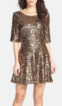 The perfect holiday party dress! You can never go wrong with sequins.