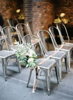 aluminum ceremony chairs, photo by Jen Huang http://ruffledblog.com/intimate-wedding-at-the-foundry-in-brooklyn #weddingceremony #ceremonies