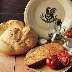 Pa amb tomata from Catalonia.  What you need: Bread (the most tradition is the pagès)  Tomato   Extra virgen olive oil   Salt