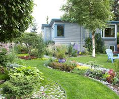 Break up Open SpacesGive your garden an exciting, contemporary feel by breaking up the lawn into small sections. Here, the Amstrups gave their lawn a flowing design, punctuated by colorful flowerbeds. It adds more interest than colorful borders surrounding a big patch of grass. Virginia Amstrup' garden in Alaska.