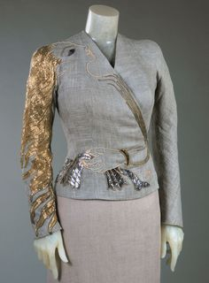 Fall 1937, France - Dinner Jacket by Elsa Schiaparelli - Linen plain weave, gilded metallic and silk thread embroidery, beads, and paillettes