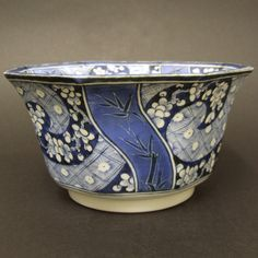 An 18th Century Blue and White Japanese Porcelain Bowl, Arita Kilns c.1770-1790. Decorated Using the White Porcelain as Well as Sumihajiki to Depict Gnarled Prunus within Textile Inspired Designs. The Well Painted with Kirin (In Chinese Qilin or Kylin).