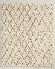 RH TEEN's Sotto Shag Rug:Partially submerged under shaggy ivory pile, colorful diamonds look casually sketched onto this hand-knotted wool-blend rug. The twisted strands change direction underfoot, revealing different aspects of the design and forming mounds of plush, foot-friendly softness.