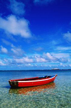 La Digue Island, Seychelles  Small boat at anchor.