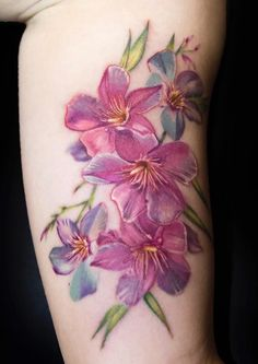 Mikhail Anderson watercolor flower tattoo