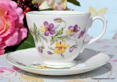 Royal Burlington fine bone china Viola pattern teacup and saucer with green rims.