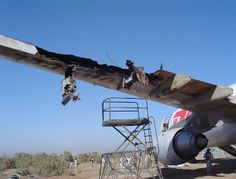 DHL cargo jet wing explosion in flight from missile. Main HYD system was disabled. Pilot managed to land only with trim and engines...