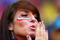 A France fan with painted face and nails in preparation for the Round of 16 match between France and Nigeria at Estadio Nacional on June 30, 2014 in Brasilia, Brazil.