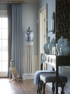 The greyhound makes the house a home.    Design in Depth: Greenwich Style | New England Home Magazine