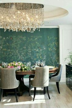 Circular ceiling, pendant lighting, dining table , n chairs side table n a green wallpaper to make a dining perfect n classic with neu blend of flowers n wallpaper