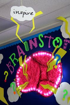 Brainstorm Bulletin board with lights and fun neon colors.