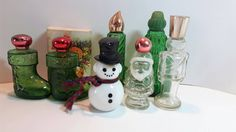 Collection of 7 Christmas Themed Avon cologne decanters by KathleenNCo on Etsy