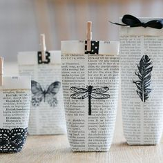 Use pages from an old book, stamp and fold them into small gift bags. Tutorial in English and Swedish.