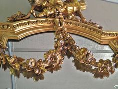 1stdibs.com | Carved Gilt Wood Pier Mirror trophy of love Theme c. 1860