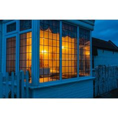 Lit window at night Mudeford Quay Christchurch Dorset England United Kingdom www.alamy.com/image-details-popup.asp?ARef=F1B5HN prime.500px.com/photos/125914081 www.aprishot.com/media.details.php?mediaID=392 #architecture #blinds #cosy #cozy #dark #dusk #electricity #exterior #front #glass #home #house #Illuminated #inside #lamp #light #lit #night #nobody #old #outdoors #outside #scene #space #structure #view #wall #warm #window #wood