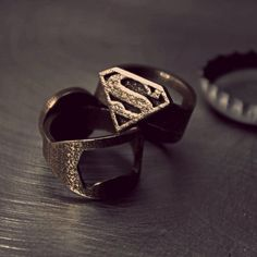 Superman Ring (and bottle opener?) I'd love this for use when I Bartend . My customers would flip. = )