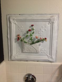 An old metal ceiling tile with a wall pocket attached. Metal Ceiling Tiles, Silk Flower Arrangements, Wall Pockets, Silk Flowers, Canvas Art, Antiques, Modern, Crafts, Tile Art