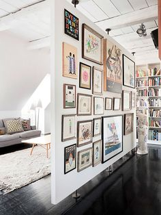 Love this divider. Will definitely have a full picture wall like this someday. Looks like a gallery.