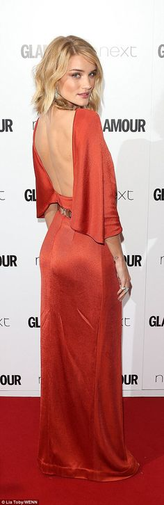 Showing some leg: Rosie Huntington-Whiteley covered up, up top but flashed some skin with ...