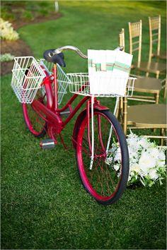 use a bike to hold your wedding programs #bikeatwedding #themedwedding #wizardofoz http://www.weddingchicks.com/2014/01/09/wizard-of-oz-wedding-ideas/