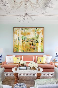Our Best Living Room Wall Decor Ideas | A vibrant painting pops off the pastel blue walls of this pool house in Lexington, Kentucky. #decorideas #homedecor #southernliving