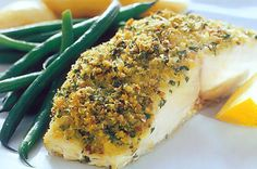 Parmesan-crumbed baked fish.  Primal hack:  replace breadcrumbs with ground almonds