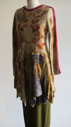 Nice way to manage the neck and sleeves when repurposing for larger size
