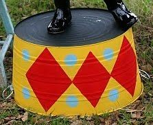 old washtub painted like circus barrel to hold toys
