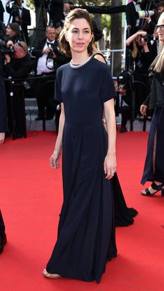 Cannes 2014: Sofia Coppola in a classic floor-grazing black creation by Valentino that she accessorized with a diamond collar necklace.