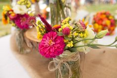 flowers in ball jars with twine