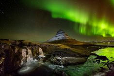 Ingólfur Bjargmundsson  - Kirkjufell | Mt Kirkjufell and Kirkjufellsfoss (waterfall) in west Iceland in green hue's after a geomagnetic storm.  To capture this you need a tripod, good low light camera or/and and fast wide lens.  In this case I used a Canon 5d3 and a 14mm f2.8 Rokinon lens at f2.8, Iso 12800 and 18 sec.  The auroras vary in brightness from being barley visible to lighting up your surroundings so there is no universal camera setting that works all the time. Sometimes the…