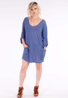 The ultimate grab n go. This dress features a loose fit, with a low scoop  neck…