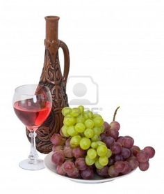 Bright still life with grapes and wine on white Stock Photo