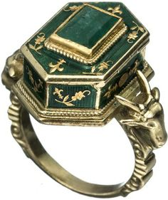 This enamel, gold, and emerald poison ring from the Victorian Era also features ram's heads, an occult symbol.