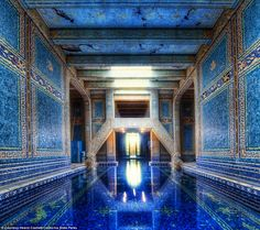 California dreaming: The striking indoor Roman tiled pool at the castle is one of several that dots the 165-room property in San Simeon
