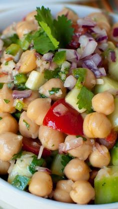 Chickpea Salad...used 1 cup each cherry tomatoes and cucumber no vinegar or mustard or pepper over couscous and quinoa and it was so good! My husband loved it!