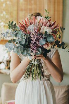Protea bouquet for country wedding | iZO Photography | See more: http://theweddingplaybook.com/romantic-australian-bush-wedding/
